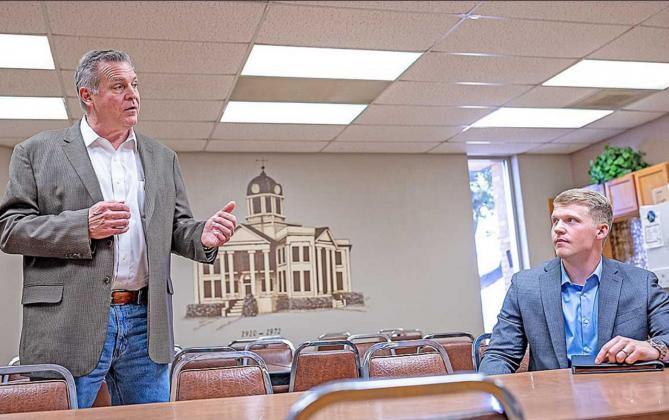 Along with son, Reid Spiller, HD-68 Candidate David Spiller, explained, at the Fisher County Courthouse on Tuesday, that the most imment threat to rural communities is the possiblity of a silenced voice in Austin through redistricting.